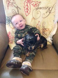 Hunter loves his puppies!